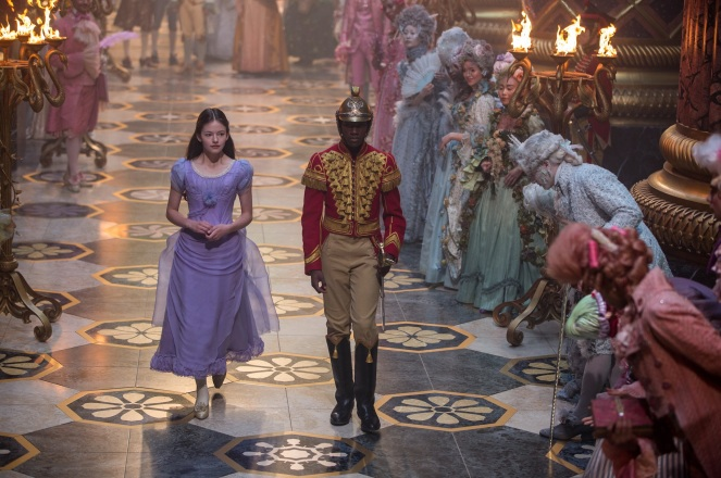 Mackenzie-Foy-walking-through-court-in-The-Nutcracker-and-the-Four-Realms